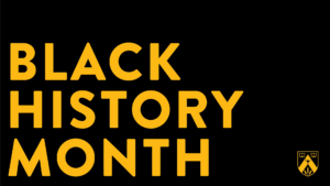 Black History Month in gold on a black background