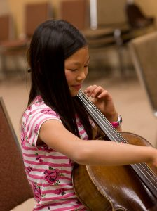 Female student playing cello