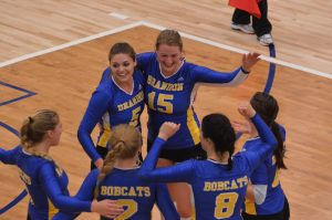 BU Women's Volleyball players celebrating.