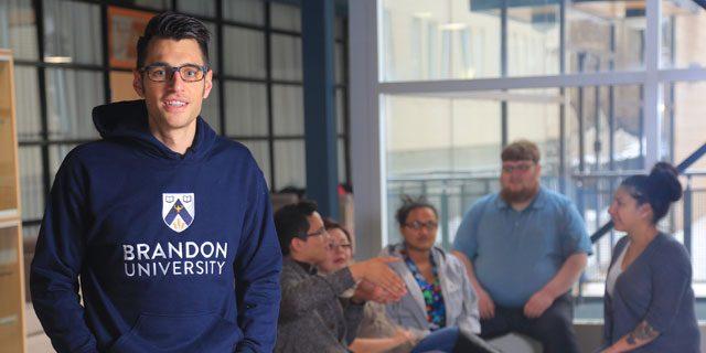 Male student in BU hoodie.