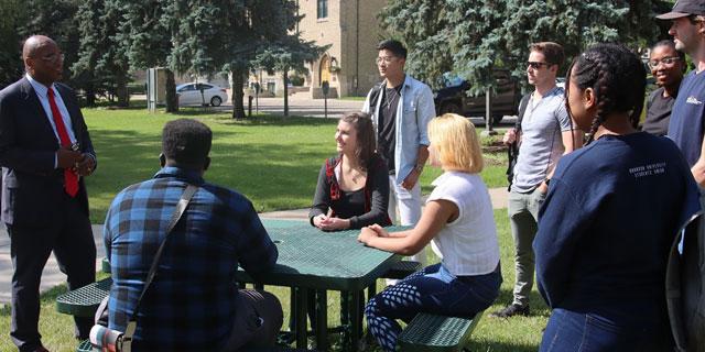 Dr. Kofi Campbell talking to students
