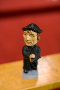A small bobblehead-style figurine.
