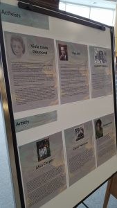 A white board features photographs and bios of those recognized for Black History Month.