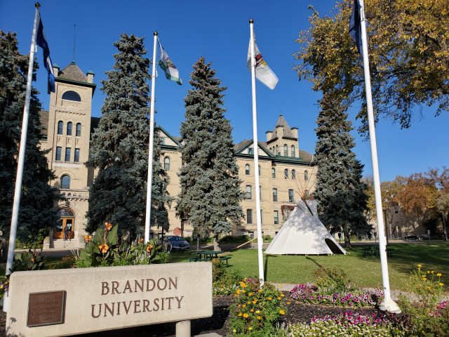 A tipi is seen in front of Brandon University