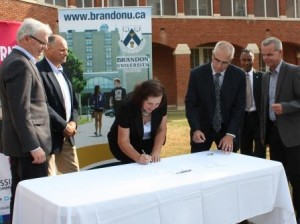 BU VP Duncan signs MOU as Premier Selinger, MLA Caldwell, ACC VO Moes BU President Fearon and Education Minister Allum look on