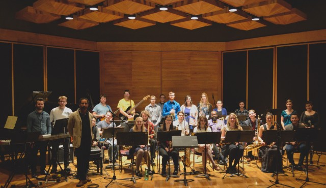 Group photo of the Big Band on stage, with instruments.