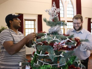 Brandon University Students' Union Vice-President External Rhoni Mohanraj and President Joel Springer decorate for 2014 Campus Christmas
