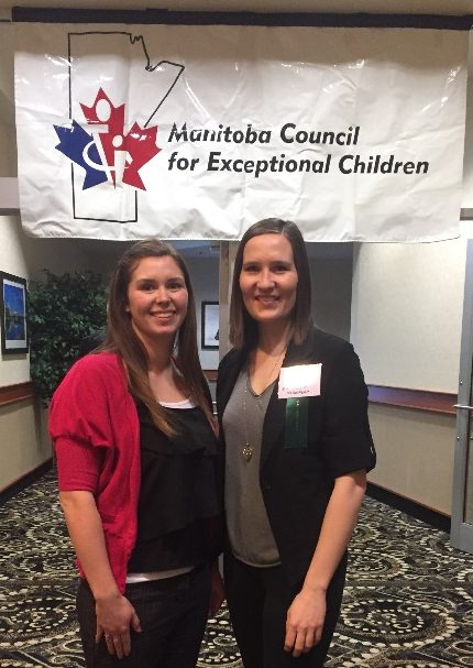 Cochrane and Drummond pose below and in front of a banner for the Manitoba Council for Exceptional Children