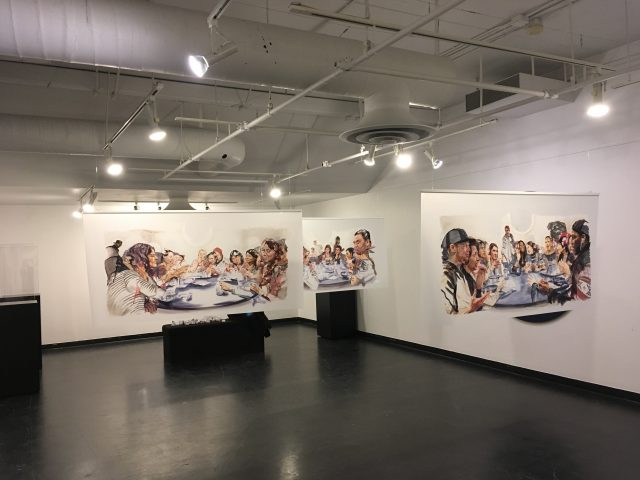 large surreal paintings hang in a gallery, showing people eating in a stylized way