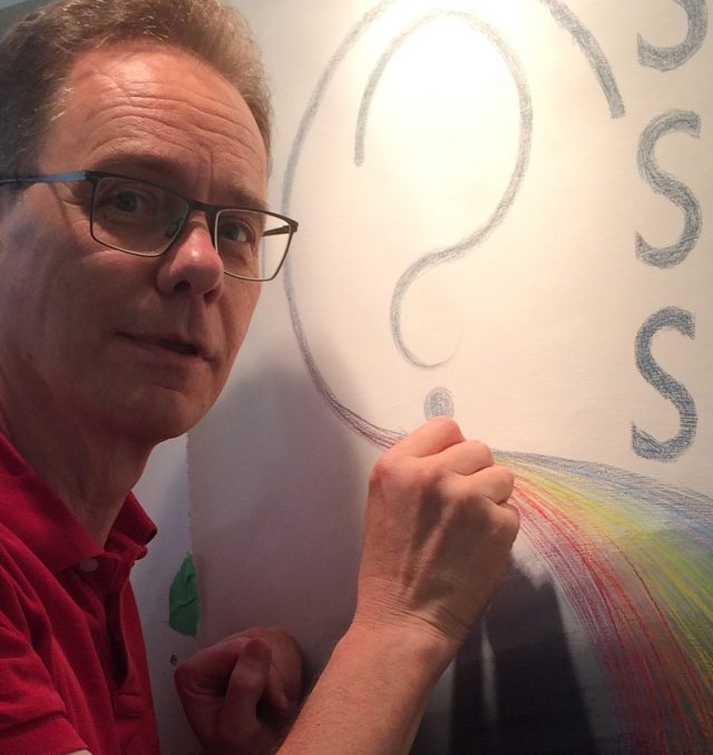 Curt Shoultz draws on a canvas.