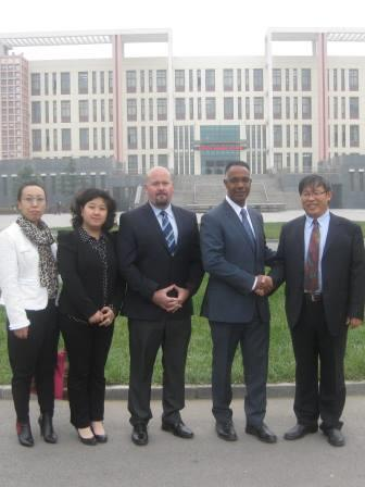 Dr. Fearon and Rowland with university officials in China, 2014 (web)
