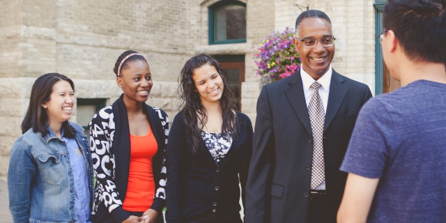 Dr. Gervan Fearon with students, 2014 (web banner)
