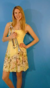 Kayla Solomon poses with a trumpet.