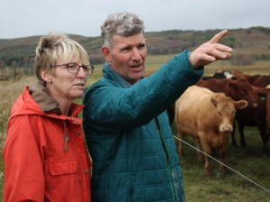 Linda and Ian Grossart with organic cattle on Howpark Farms south of Brandon