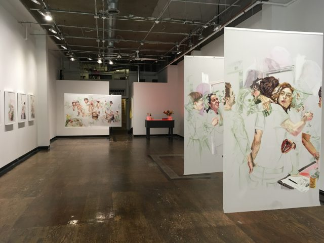 A pair of images are visible on the right side of an art gallery. A third image is seen in the distance on the left. The images show people socializing.
