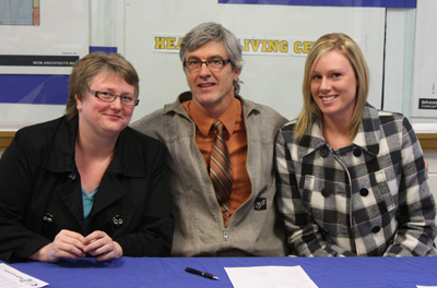 Meaghan Robertson, signing letter of intent to play at BU. Joined by her mother Pam and BU Athletic Director, Kirk De Fazio.
