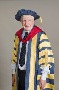 Michael Decter poses in academic regalia.