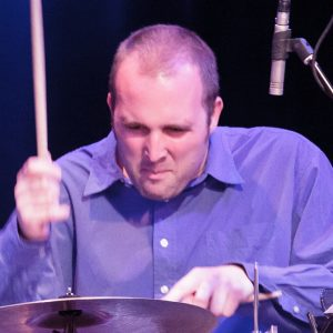 Close-up photo of Nick Fraser playing a cymbal