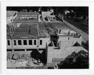 Black and white photo of a large construction site.