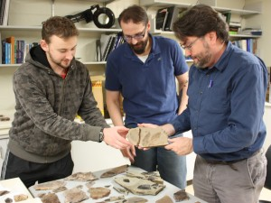 Students Cale Gushulak and Christopher West with Dr. David Greenwood viewing McAbee fossils