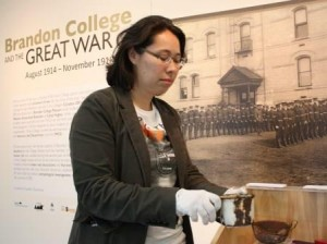 Suyoko Tsukamoto prepares 'Brandon College and the Great War' exhibit