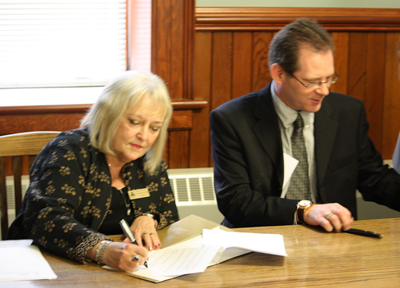 BU President & Vice Chancellor, Dr. Deborah Poff signs agreement with ACC Interim President & CEO, Mr. Jim Brinkhurst
